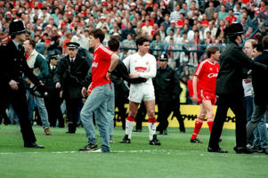 Fan in despair after the Hillsborough Disaster