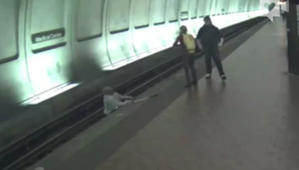 Good Samaritans rush to save man in train's path