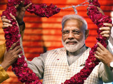 NEW DELHI, INDIA - APRIL 19: Prime Minister Narendra Modi being garlanded at ''Traders Sammelan' at Talkatora Stadium, on April 19, 2019 in New Delhi, India. Modi said the BJP-led NDA government in the last five years at the Centre worked to simplify lives and businesses of traders by scraping 1,500 archaic laws, simplifying processes and providing easy credit. (Photo by Raj K Raj/Hindustan Times via Getty Images)