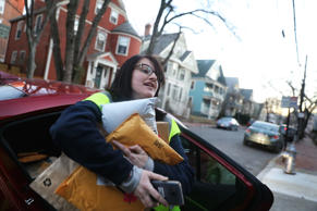 Amazon Flex driver Arielle McCain, 24, makes a delivery in Cambridge, Mass., on Dec. 18, 2018.