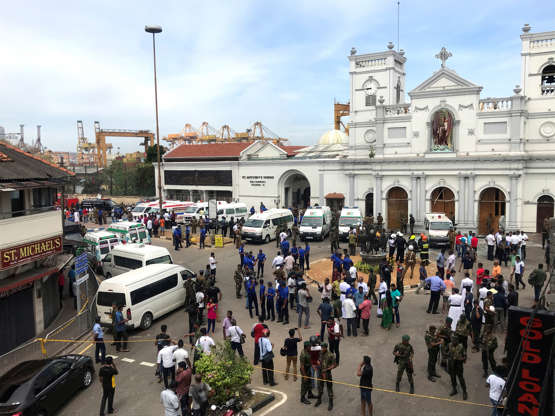 Slide 1 of 5: Sri Lankan military officials stand guard in front of the St. Anthony's Shrine, Kochchikade church after an explosion in Colombo, Sri Lanka April 21, 2019.