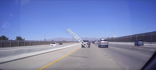 Car runs over ladder on highway