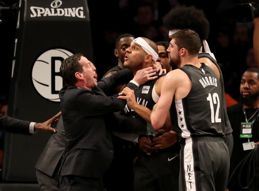 NEW YORK, NEW YORK - APRIL 20:   Head coach Kenny Atkinson and Joe Harris #12 of the Brooklyn Nets hold back Jared Dudley #6 at Barclays Center after a foul by Joel Embiid of the Philadelphia 76ers in the third quarter on April 20, 2019 in the Brooklyn borough of New York City.The Philadelphia 76ers defeated the Brooklyn Nets 112-108. NOTE TO USER: User expressly acknowledges and agrees that, by downloading and or using this photograph, User is consenting to the terms and conditions of the Getty Images License Agreement. (Photo by Elsa/Getty Images)