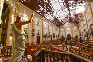 Officials inspect the damaged St. Sebastian's Church after multiple explosions targeting churches and hotels across Sri Lanka on April 21, in Negombo, north of Colombo, Sri Lanka.