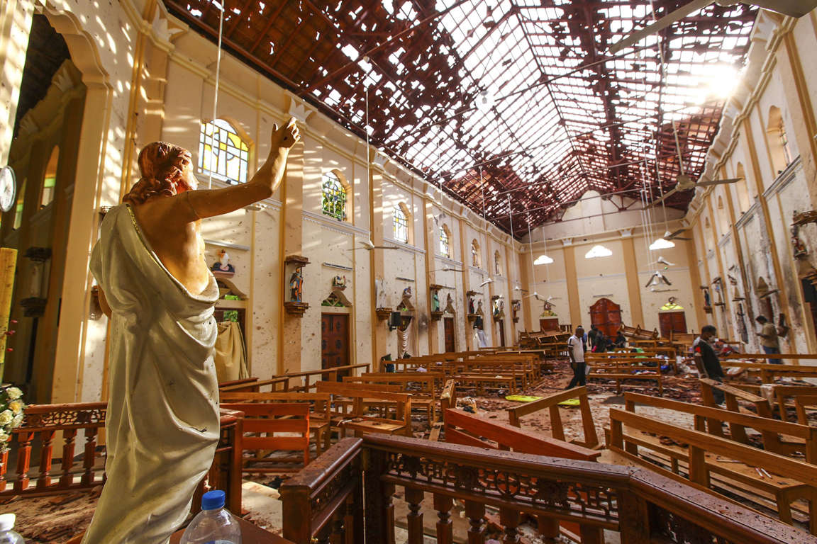Slide 1 of 56: Officials inspect the damaged St. Sebastian's Church after multiple explosions targeting churches and hotels across Sri Lanka on April 21, in Negombo, north of Colombo, Sri Lanka.