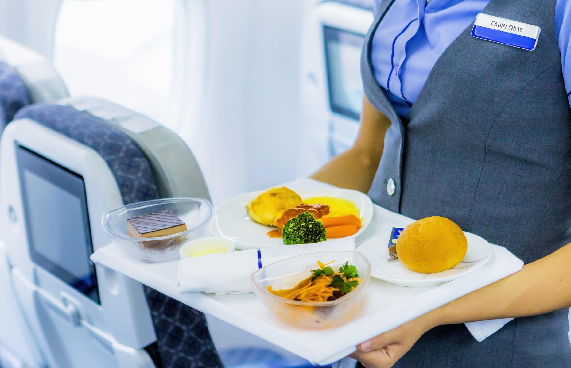 """Slide 34 of 63: """"With the exception of a few 5-star international airlines, we don't actually cook on board,"""" says Leandi. """"The meals are prepared a couple of days in advance and packaged. That's why if you have a special dietary requirement, we ask that you tell us about it 48 hours in advance. Then when we get on board, we just pop the meals in the oven and heat them for 30 minutes before serving them to you on the meal trays."""""""