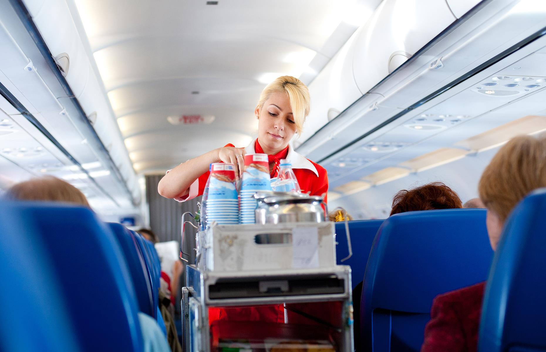 Slide 6 of 63: Before you board the plane, flight attendants will have carried out a safety check and ensured the plane is clean and tidy. They then welcome passengers on board and prepare and serve food and drinks. A lot of time is spent ensuring passengers are comfortable and at ease – and in rare cases, a flight attendant might have to carry out first aid or restrain a passenger.