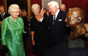 Queen Elizabeth ll chats to Field Marshall the Lord Bramall and Lady Plastow, the sculptor of the bust of Lord Bramall seen on the right, as she bids farewell to the Royal Green Jackets ahead of a major restructuring of the army during a reception at Buckingham Palace on October 10, 2006