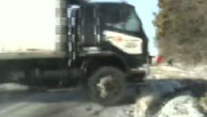 'Miracle' near-miss as jackknifing truck narrowly misses Illinois cops