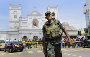 In this Sunday, April 21, 2019, Sri Lankan Army soldiers secure the area around St. Anthony's Shrine after a blast in Colombo, Sri Lanka. Sri Lankan authorities blame seven suicide bombers of a domestic militant group for coordinated Easter bombings that ripped through Sri Lankan churches and luxury hotels which killed and injured hundreds of people. It was Sri Lanka's deadliest violence since a devastating civil war in the South Asian island nation ended a decade ago. (AP Photo/Eranga Jayawardena, file)