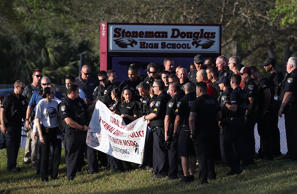 PARKLAND, FL - FEBRUARY 28:  Police officers stand in front of Marjory Stoneman Douglas High School as students arrive to attend classes for the first time since the shooting that killed 17 people on February 14  at the school on February 28, 2018 in Parkland, Florida.  Police arrested 19-year-old former student Nikolas Cruz for the 17 murders.  (Photo by Joe Raedle/Getty Images)
