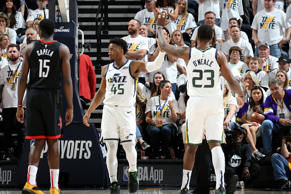 SALT LAKE CITY, UT - APRIL 22: Donovan Mitchell #45 and Royce O'Neale #23 of the Utah Jazz high five during Game Four of Round One of the 2019 NBA Playoffs against the Houston Rockets on April 22, 2019 at vivint.SmartHome Arena in Salt Lake City, Utah. NOTE TO USER: User expressly acknowledges and agrees that, by downloading and/or using this photograph, user is consenting to the terms and conditions of the Getty Images License Agreement. Mandatory Copyright Notice: Copyright 2019 NBAE (Photo by Melissa Majchrzak/NBAE via Getty Images)