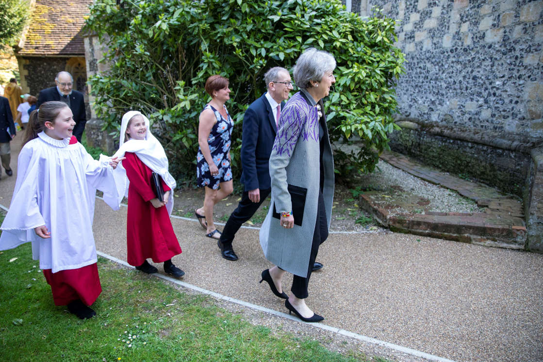 Prime Minister Theresa May and her husband Philip leave an Easter Sunday church service near her Maidenhead constituency.