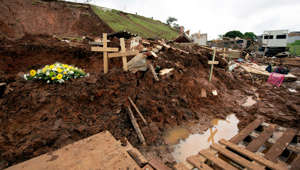 Crosses are seen where a house was destroyed after massive flooding in Chatsworth near Durban, South Africa, April 24, 2019.