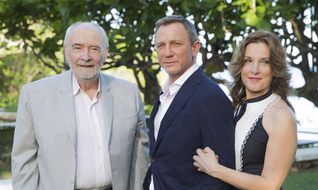 Slide 1 of 9: CAPTION: Producers Michael G Wilson, left, and Barbara Broccoli, right, pose for photographers with actor Daniel Craig during the photo call of the latest installment of the James Bond film franchise, currently known as 'Bond 25', in Oracabessa, Jamaica, Thursday, April 25, 2019. (AP Photo/Leo Hudson)