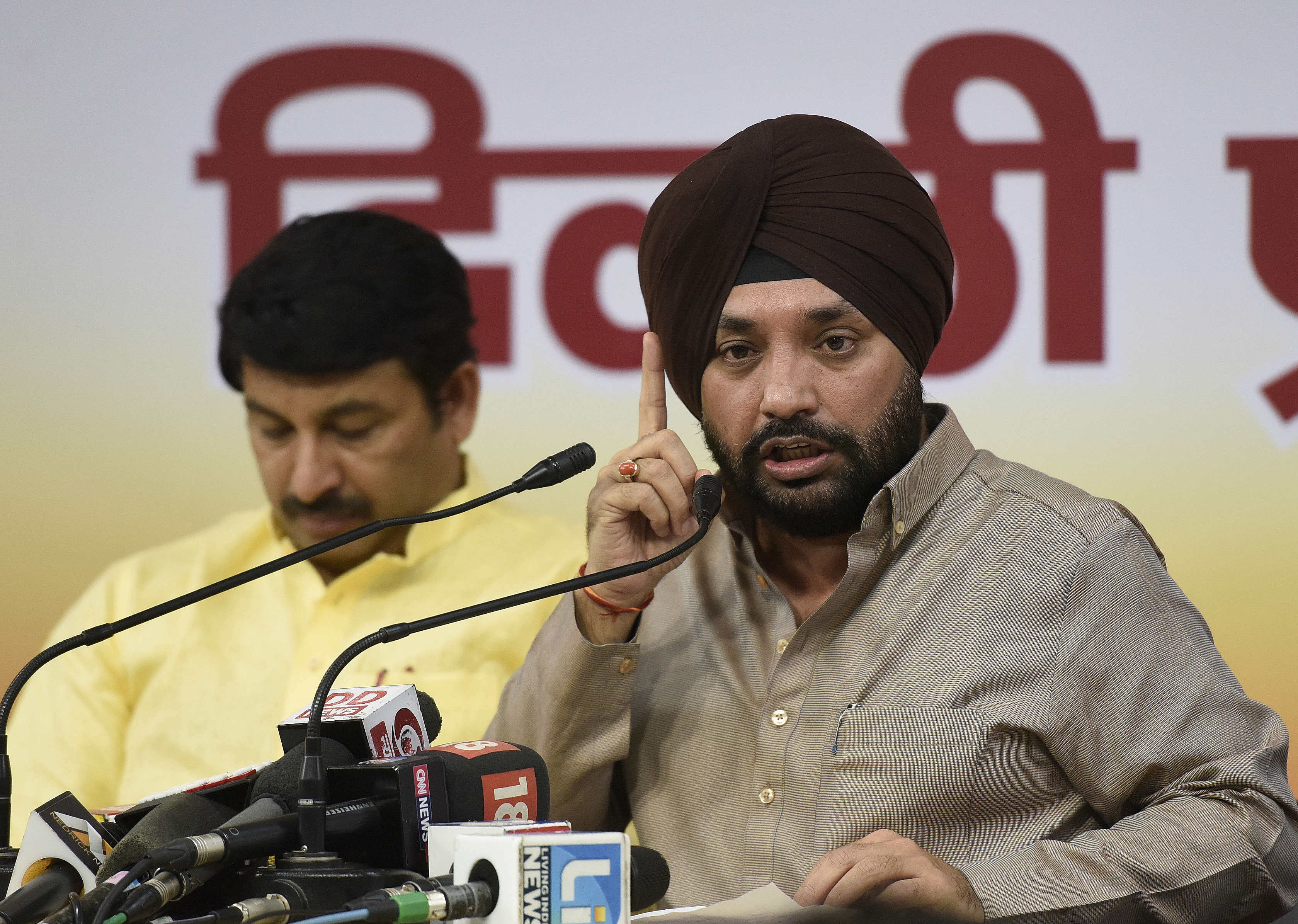Slide 23 of 31: NEW DELHI, INDIA - OCTOBER 5:   Delhi BJP President Manoj Tiwari, and Leader Arvinder Singh Lovely address a Press Conference on the Issue of Guest Teacher Bill and other issue at his Party Office   on October 5, 2017 in New Delhi, India.  (Photo by Sonu Mehta/ Hindustan Times via Getty Images)