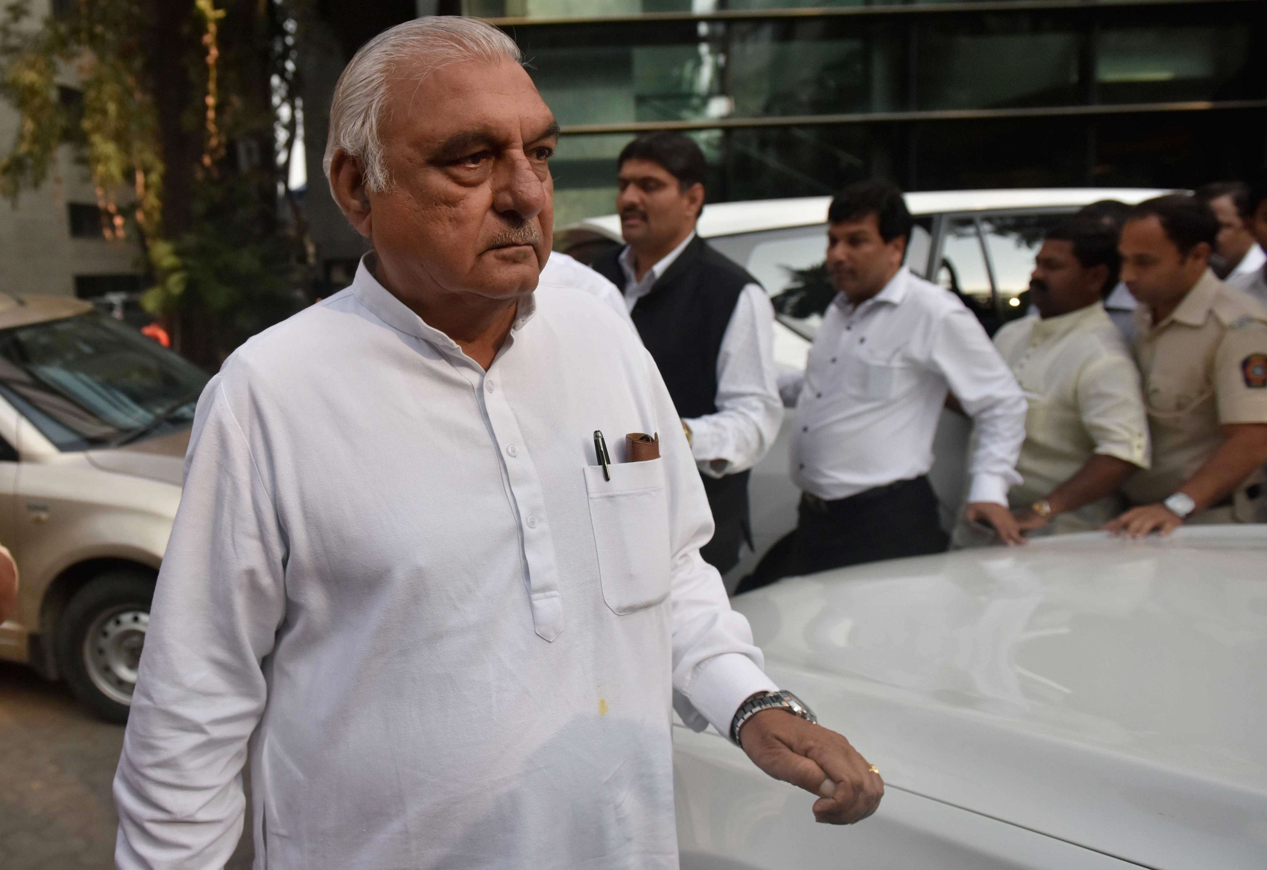Slide 17 of 31: MUMBAI, INDIA - JANUARY 25: Former Chief Minister of Haryana Bhupinder Singh Hooda after the party internal meeting to take of the situation in view of the BMC polls, at Garware Club House, on January 25, 2017 in Mumbai, India. (Photo by Arijit Sen/Hindustan Times via Getty Images)