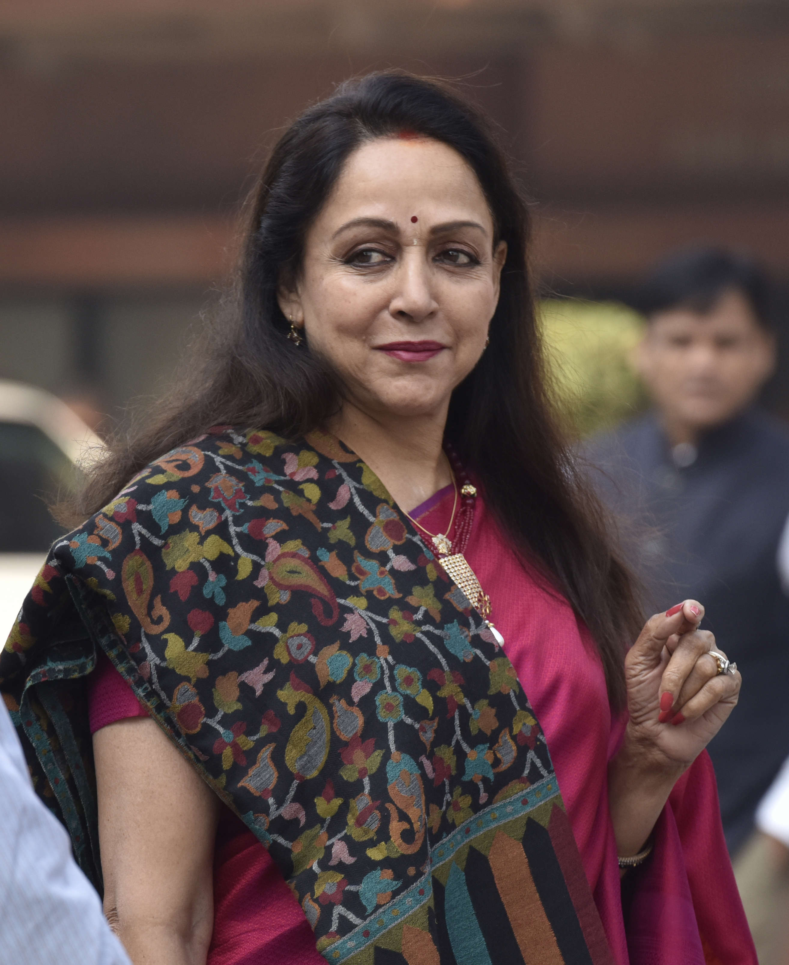 Slide 3 of 31: NEW DELHI, INDIA - DECEMBER 18: BJP MP Hema Malini seen during the winter session in Parliament, on December 18, 2018 in New Delhi, India. Lok Sabha proceedings lasted barely for an hour as Speaker Sumitra Mahajan adjourned the House for the day amid slogan-shouting and protests by treasury and opposition benches over a range of issues, including Rafale deal. (Photo by Sanjeev Verma/Hindustan Times via Getty Images)