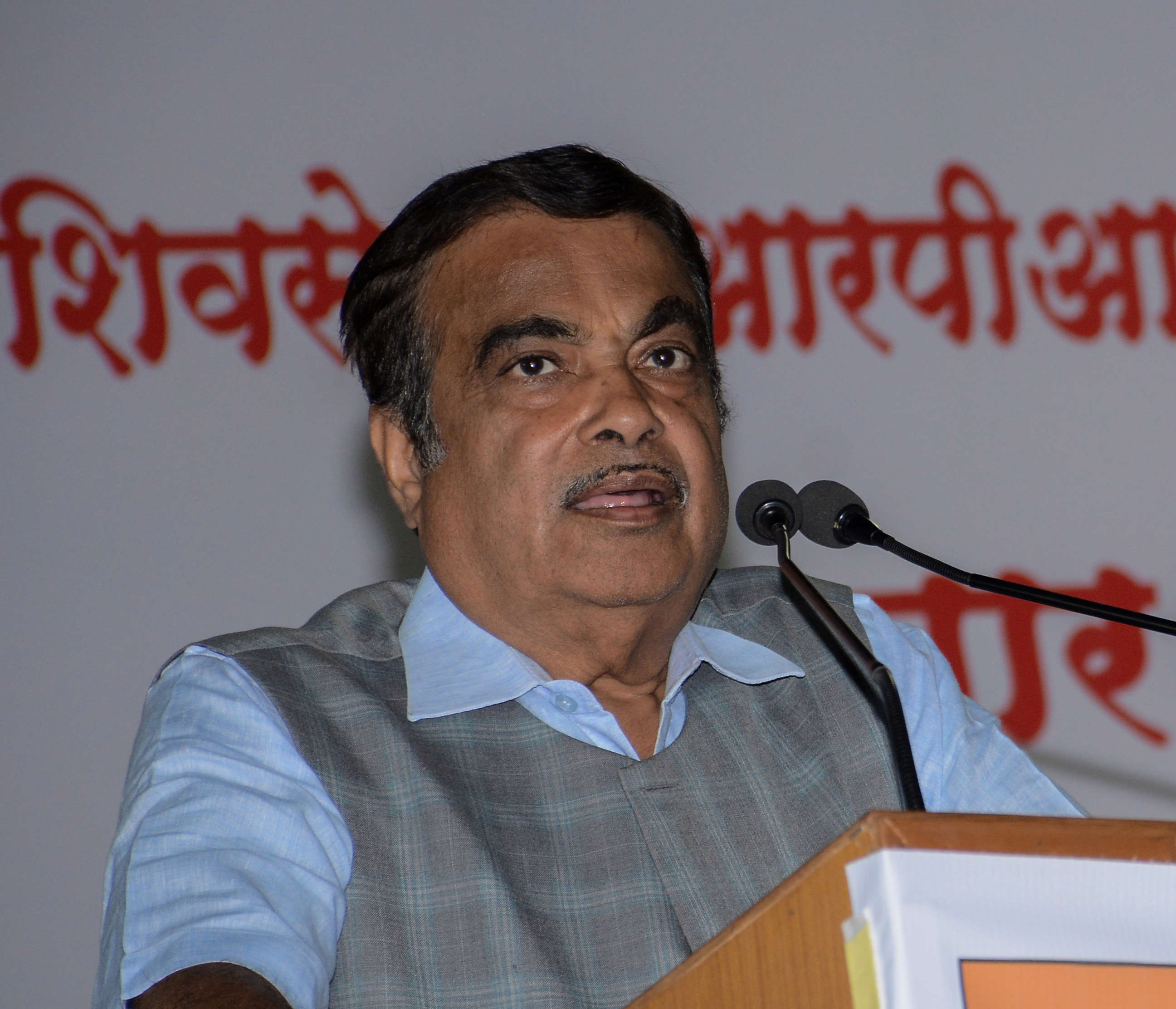Slide 11 of 31: PUNE, INDIA - APRIL 20: Union Minister Nitin Gadkari during a public rally for Pune BJP candidate Girish Bapat at Kothrud, on April 20, 2019 in Pune, India. Barely three days after Prime Minister Narendra Modi said he was being targeted because of his backward caste, senior Union minister and Bharatiya Janata Party (BJP) leader Nitin Gadkari on Saturday said that asking for votes on the basis of caste and religion is not right. Those who feel ashamed to seek votes on the basis of performance take support of caste, religion and language for getting votes, Gadkari said, while addressing an evening rally in support of Girish Bapat, the BJPs candidate for the Pune Lok Sabha seat. He criticised political leaders for seeking votes on the basis of caste and religion. (Photo by Milind Saurkar/Hindustan Times via Getty Images)