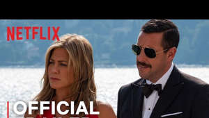 a person wearing a suit and tie: When an NYC cop (Adam Sandler) finally takes his wife (Jennifer Aniston) on a long promised European trip, a chance meeting on the flight gets them invited to an intimate family gathering on the Super Yacht of elderly billionaire Malcolm Quince. When Quince is murdered, they become the prime suspects in a modern day whodunit. MURDER MYSTERY reunites Adam Sandler and Jennifer Aniston along with an ensemble cast of global talent.  Watch Murder Mystery on Netflix: https://www.netflix.com/title/80242619  SUBSCRIBE: http://bit.ly/29qBUt7  About Netflix: Netflix is the world's leading internet entertainment service with over 148 million paid memberships in over 190 countries enjoying TV series, documentaries and feature films across a wide variety of genres and languages. Members can watch as much as they want, anytime, anywhere, on any internet-connected screen. Members can play, pause and resume watching, all without commercials or commitments.  Connect with Netflix Online: Visit Netflix WEBSITE: http://nflx.it/29BcWb5 Like Netflix Kids on FACEBOOK: http://bit.ly/NetflixFamily Like Netflix on FACEBOOK: http://bit.ly/29kkAtN Follow Netflix on TWITTER: http://bit.ly/29gswqd Follow Netflix on INSTAGRAM: http://bit.ly/29oO4UP Follow Netflix on TUMBLR: http://bit.ly/29kkemT  Murder Mystery | Trailer | Netflix http://youtube.com/netflix