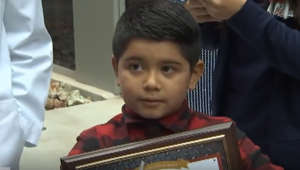 Quick-thinking 7-year-old saves his mother's life
