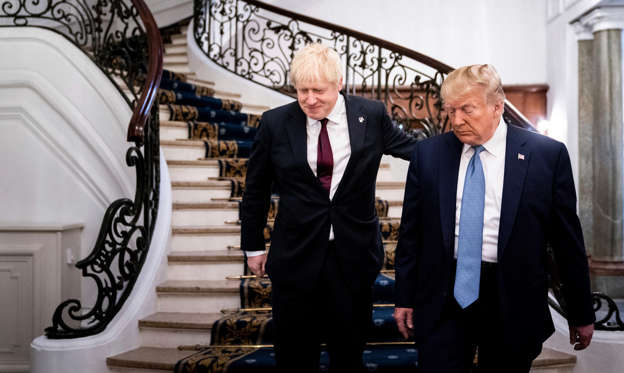 Boris Johnson in a suit standing in front of a building: Prime Minister Boris Johnson of Britain with President Trump at the Group of 7 meeting in Biarritz, France, in August.