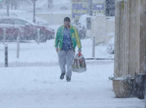 A person walks in snowy conditions in Rathcoole in Dublin.