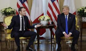 Emmanuel Macron, Donald Trump are posing for a picture: Photograph: Evan Vucci/AP