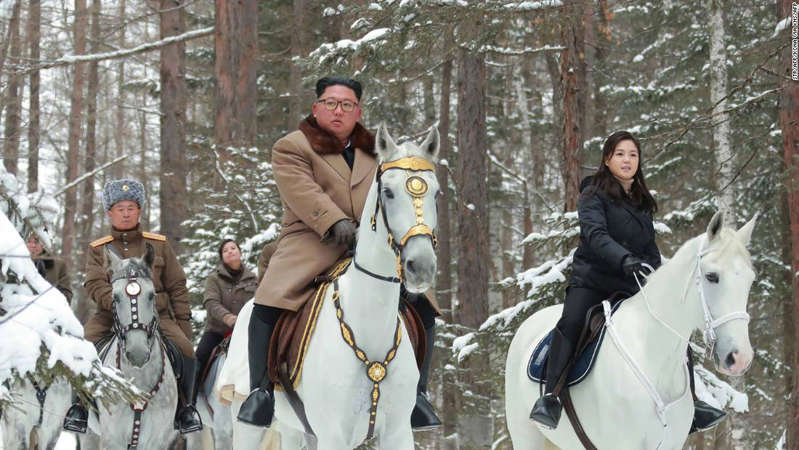 Kim Jong-un et al. riding on the back of a horse: This undated photo released by North Korea's official Korean Central News Agency Wednesday shows North Korean leader Kim Jong Un (center), his wife Ri Sol Ju (right, in black) and Pak Jong Chon (left, in the grey hat) visiting Mount Paketu.