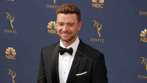Justin Timberlake wearing a suit and tie
