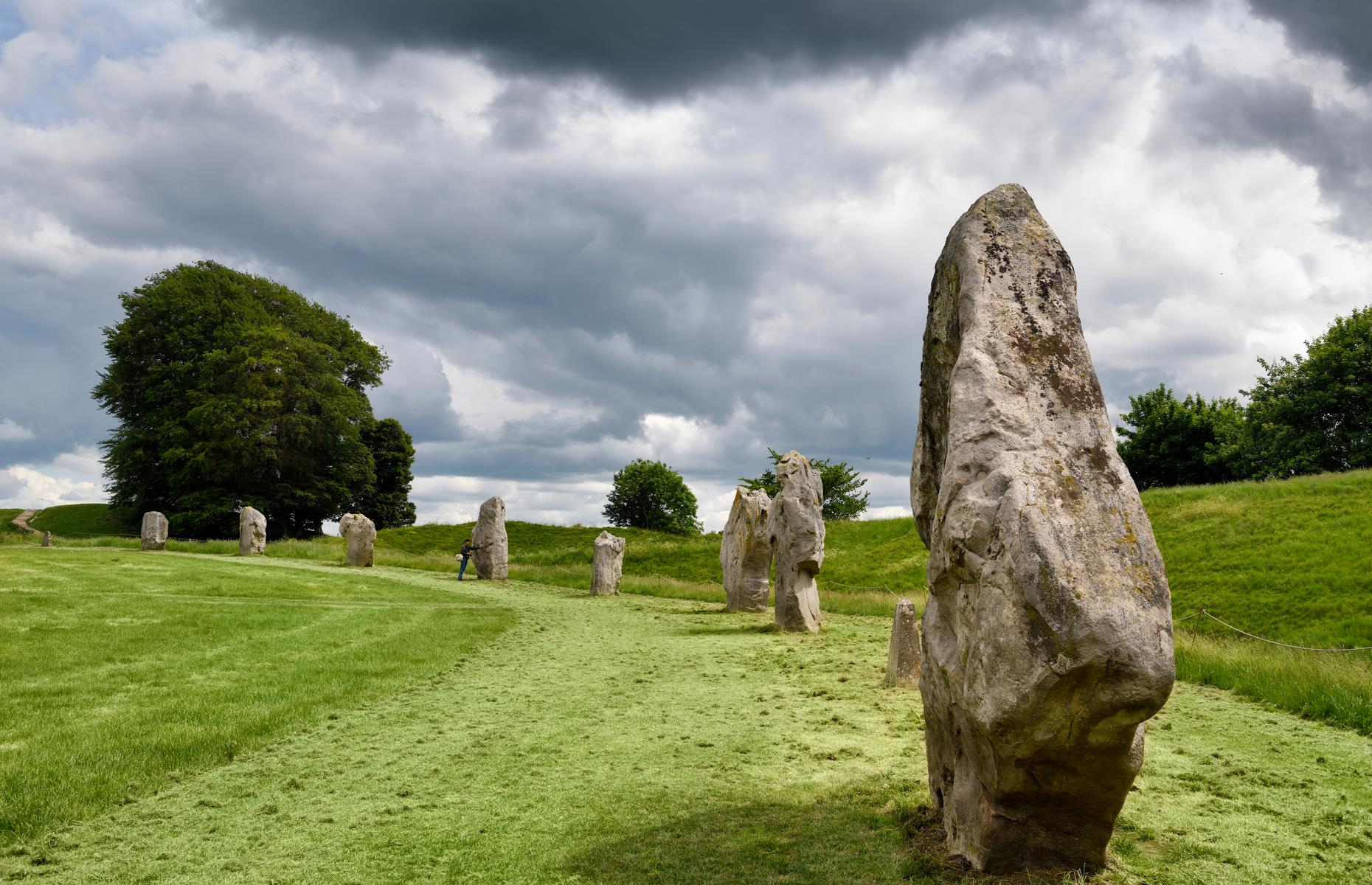 Slide 23 of 41: Just a 40-minute drive north from Stonehenge is the quiet village of Avebury, where you'll find the largest stone circle in the world. This architectural sensation, which dates back to Neolithic times, is free to visit and only attracts a fraction of the tourists heading to Stonehenge.  Best of all, you can wander at your leisure between the vast boulders and out of season, you may only have a few local sheep for company.