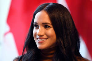 a close up of Meghan Markle with red hair looking at the camera: Duchess Meghan of Sussex visited Canada House in London with Prince Harry to say thanks for warm hospitality during their recent time-off in Canada, Jan. 7, 2020.