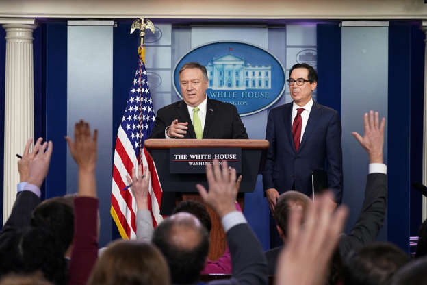 Slide 1 of 58: U.S. Secretary of State Mike Pompeo and Treasury Secretary Steven Mnuchin announce new sanctions on Iran in the Brady Press Briefing Room of the White House in Washington, U.S., January 10, 2020.