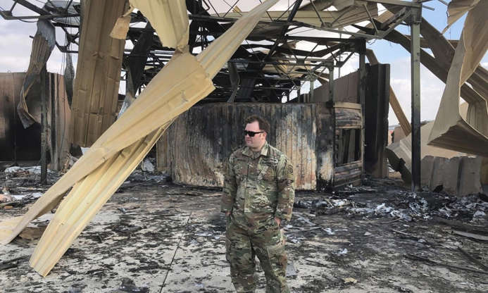 Slide 2 of 50: A U.S. soldier stands at a site of Iranian bombing, in Ain al-Asad air base, Anbar, Iraq, Monday, Jan. 13, 2020.