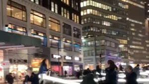 Never too old! Glowing seesaws prove a big hit in midtown Manhattan