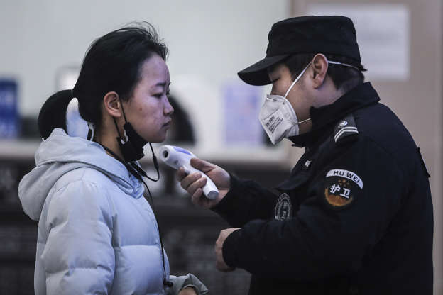 "Slide 1 of 13: WUHAN, CHINA - JANUARY 22: (CHINA OUT) Security personnel check the temperature of passengers in the Wharf at the Yangtze River on January 22, 2020 in Wuhan, Hubei province, China. A new infectious coronavirus known as ""2019-nCoV"" was discovered in Wuhan as the number of cases rose to over 400 in mainland China. Health officials stepped up efforts to contain the spread of the pneumonia-like disease which medicals experts confirmed can be passed from human to human. The death toll has reached 17 people as the Wuhan government issued regulations today that residents must wear masks in public places. Cases have been reported in other countries including the United States, Thailand, Japan, Taiwan, and South Korea. (Photo by Getty Images)"