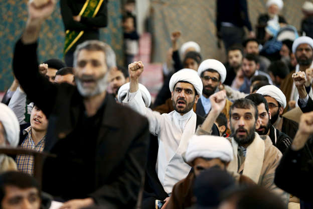 Slide 4 of 48: Iranian men chant slogans as they gather to mourn during the forty days memorial, after the killing of Iran's Quds Force top commander Qassem Soleimani in a U.S. air strike at Baghdad airport, at the grand Mosalla in Qom, Iran February 09, 2020. Nazanin Tabatabaee/WANA (West Asia News Agency) via REUTERS  ATTENTION EDITORS - THIS IMAGE HAS BEEN SUPPLIED BY A THIRD PARTY.
