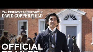 Dev Patel standing in front of a building: THE PERSONAL HISTORY OF DAVID COPPERFIELD re-imagines Charles Dickens' classic ode to grit and perseverance through the comedic lens of its award-winning filmmakers— giving the Dickensian tale new life for a cosmopolitan age with a diverse ensemble cast of stage and screen actors from across the world. Emmy® winners and Oscar® nominees Armando Iannucci (IN THE LOOP, THE DEATH OF STALIN, HBO'S Veep) and Simon Blackwell (IN THE LOOP, HBO'S Succession) lend their wry, yet heart-filled storytelling style to revisiting Dickens' iconic hero on his quirky journey from impoverished orphan to burgeoning writer in Victorian England.  #ThePersonalHistoryofDavidCopperfield #CopperfieldFilm #SearchlightPictures  Connect with Searchlight Pictures Online: Visit the Searchlight Pictures WEBSITE: https://www.searchlightpictures.com/ Like Searchlight Pictures on FACEBOOK: https://www.facebook.com/searchlightpics/ Follow Searchlight Pictures on TWITTER: https://twitter.com/searchlightpics  THE PERSONAL HISTORY OF DAVID COPPERFIELD | Official Trailer | Searchlight Pictures https://www.youtube.com/user/FoxSearchlight