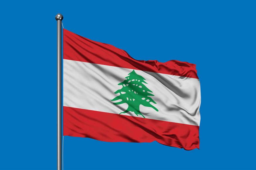 الشريحة 7 من 22: Flag of Lebanon waving in the wind against deep blue sky. Lebanese flag.