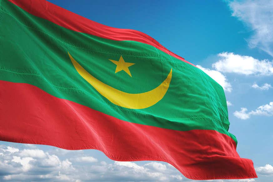 الشريحة 12 من 22: Mauritania flag waving cloudy sky background realistic 3d illustration
