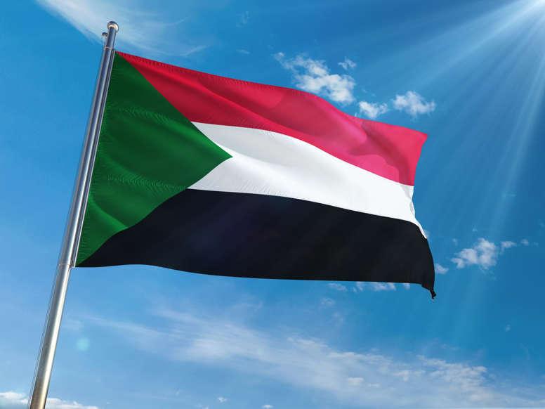 الشريحة 19 من 22: Sudan National Flag Waving on pole against sunny blue sky background. High Definition