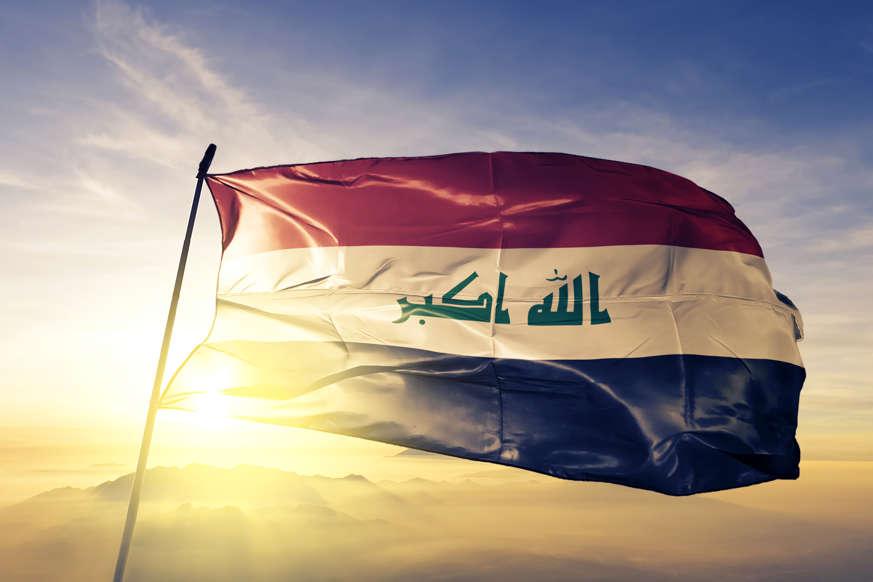 الشريحة 4 من 22: Iraq Iraqi flag on flagpole textile cloth fabric waving on the top sunrise mist fog
