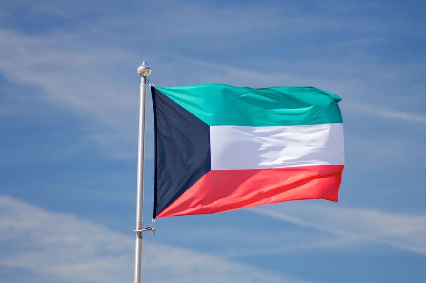 الشريحة 9 من 22: Closeup of a Kuwait flag with blue sky
