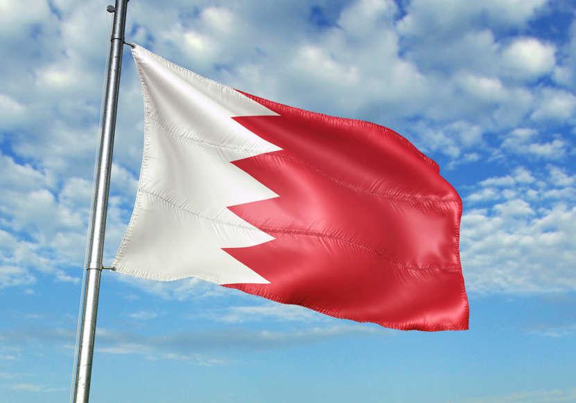 الشريحة 2 من 22: Bahrain flag on flagpole waving cloudy sky background realistic 3d illustration