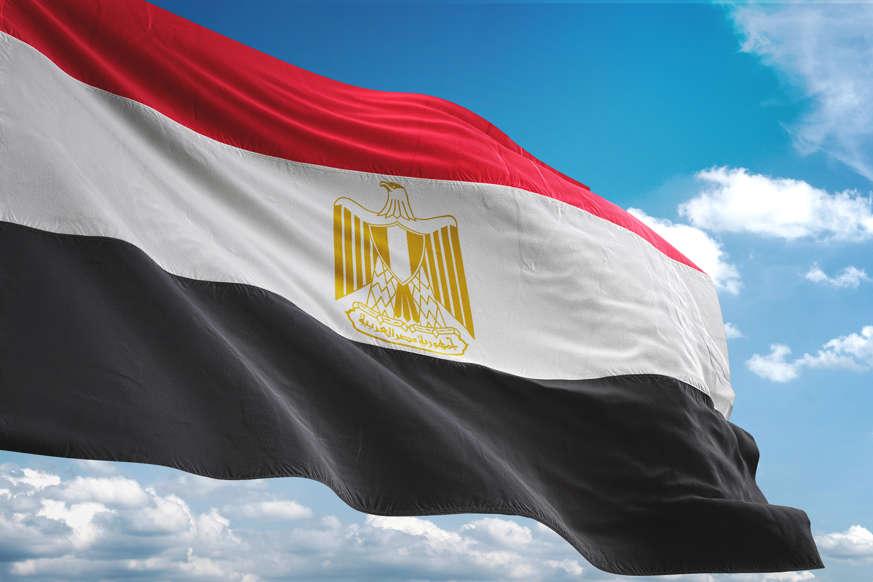 الشريحة 1 من 22: Egypt flag waving cloudy sky background realistic 3d illustration