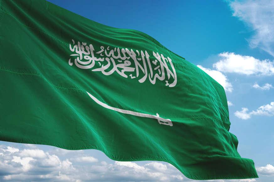 الشريحة 14 من 22: Saudi Arabia flag waving cloudy sky background realistic 3d illustration