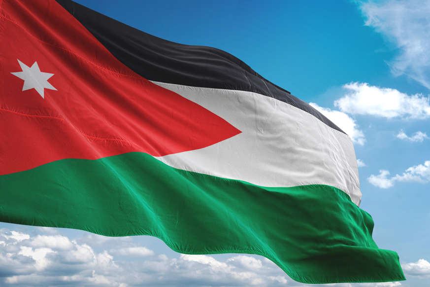 الشريحة 8 من 22: Jordan flag waving cloudy sky background realistic 3d illustration