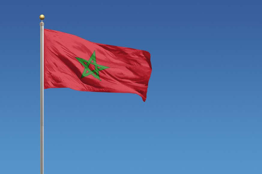 الشريحة 10 من 22: Flag of Morocco in front of a clear blue sky