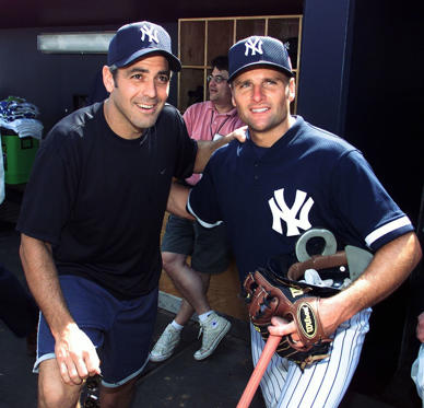 Slide 4 of 73: Actor George Clooney takes on the role of baseball fan as he gets together with New York Yankees' second baseman Chuck Knoblauch during a visit to the team's spring training camp in Tampa.