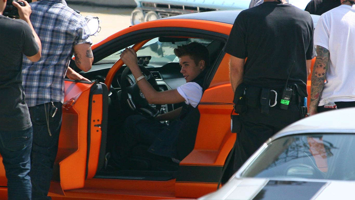 Slide 14 of 35: The star loved by teenage fans around the world, Justin Bieber was spotted filming the video for his song, Boyfriend, in this Boss 302 Ford Mustang.